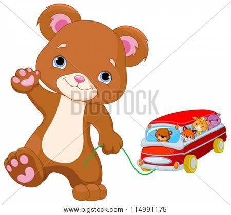 Cute Teddy Bear plays toy bus