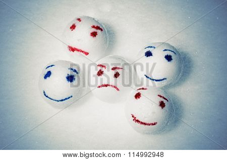 Five funny snowballs and one sad.