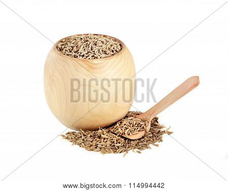 dried cumin in a wooden jar