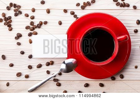 Red Coffee Cup With Business Card On Table