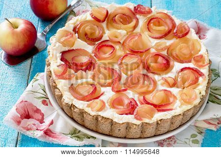 Apple Pie With Cream Roses On A Wooden Table