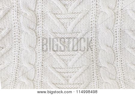 White knitted texture woolen fabric close up