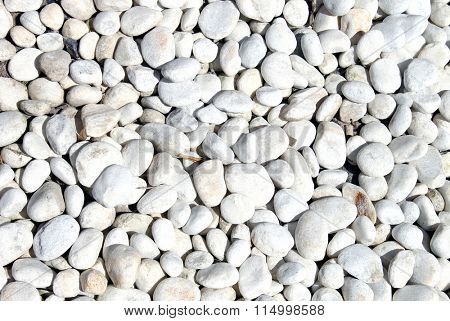 Abstract background of smooth white stones.