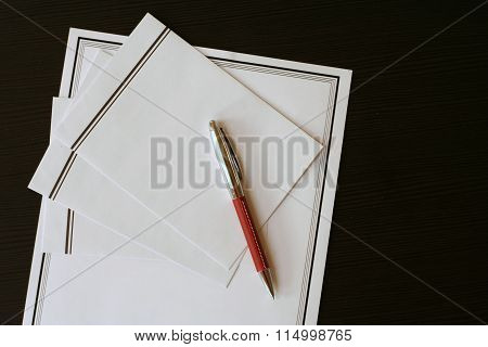 Funeral Notice (card) And Envelopes On The Black Table