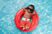 Newborn Baby Boy Floating On A Swim Ring poster
