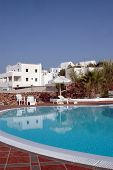 Hotel Pool With Greek Island Architecture poster