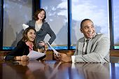foto of business meetings  - Multiethnic office workers in boardroom watching presentation laughing focus on man - JPG