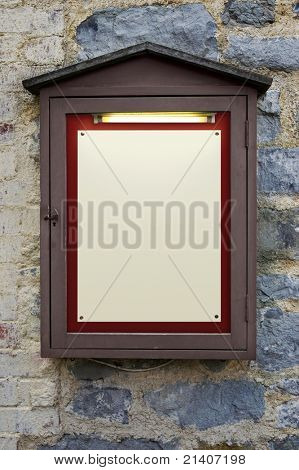 Photo of an old weathered illuminated notice board on a wall, plenty of copy space to add your own text.