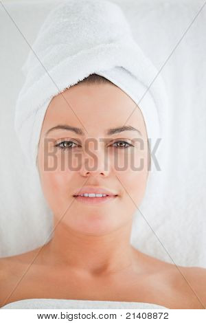 Portrait of a young woman wearing a towel in a spa