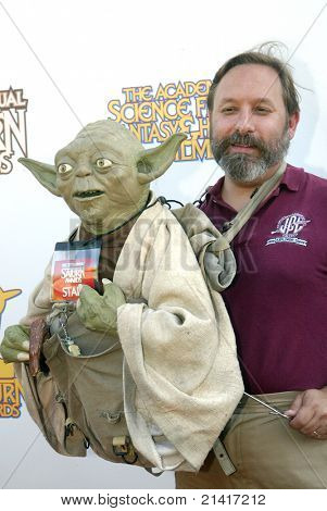 BURBANK, CA - JUNE 23: Obi Shawn and his puppet Yoda arrive at the 37th annual Saturn awards on June 23, 2011 at The Castaways restaurant in Burbank, CA.