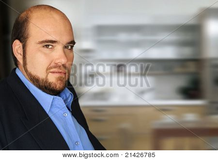 Portrait of an unhappy arrogant executive in modern office setting