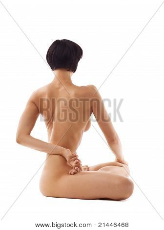 Young beauty naked woman sit in yoga pose isolated