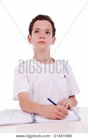 Cute Boy On The Desk Studying And Thinking, Isolated On White, Studio Shot