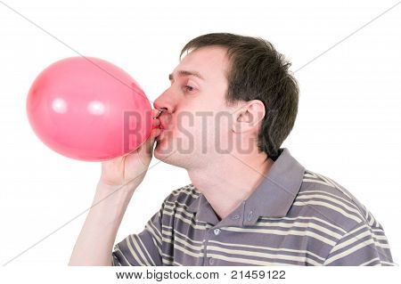 Man Inflating Red Balloon