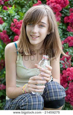 Teenage Girl With Bottle Of Water
