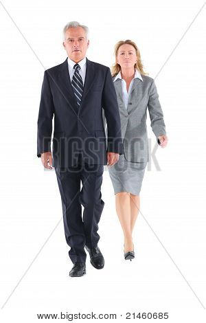 businessman and businesswoman walking in white background