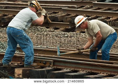 Two Men Hammering