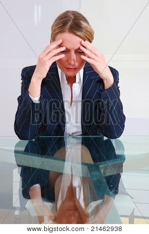 concentred businessman in office at the desk