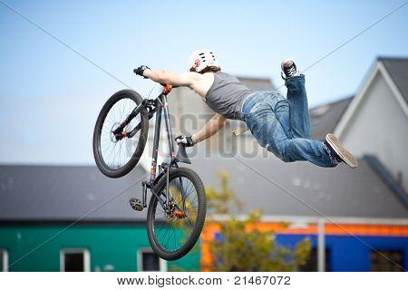 Boy On A Bmx/mountain Bike Jumping