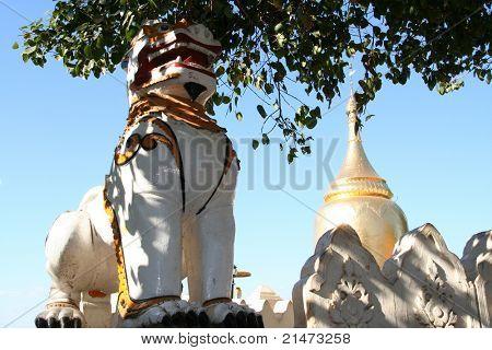 Stone lion at entrance of Shwezigon pagoda in Bagan (Myanmar)