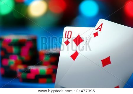 An Ace and a Ten card make Blackjack on a blue background