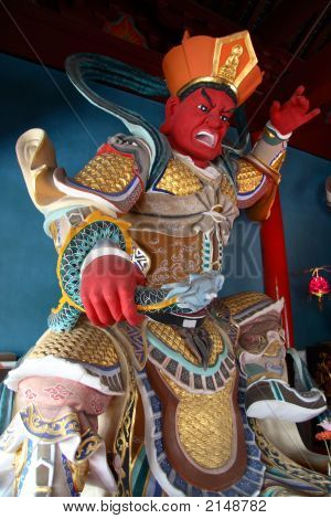 Red Statue In Buddhist Temple