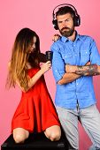 Couple In Love Wears Headphones And Holds Microphone. poster