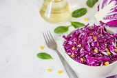 Fresh red cabbage salad with corn. Vegeterian and diet food. Space for text.