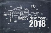 Happy New Year 2018 word cloud - white chalk text  on a blackboard, a greeting card poster