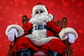Cool modern Santa Claus in sunglasses over red background. Christmas concept.  poster