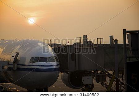 Plane At Dawn