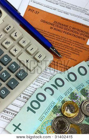The tax form with calculator, money and pen