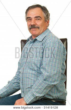 Happy Senior Executive Man On Chair