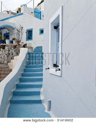 White Buildings And Blue Staircase