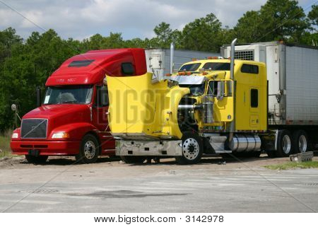 Two Trucks On A Repair Stop