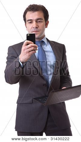 business man with laptop and cellphone