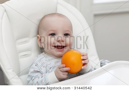 Smiling Baby With Orange