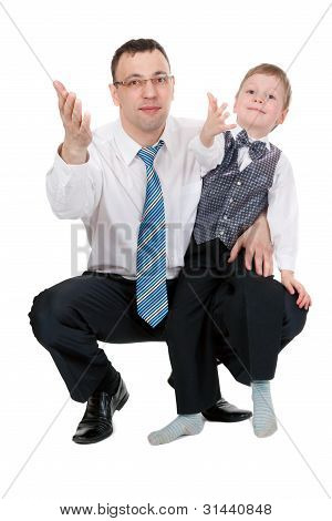 Businessman And His Son Pulled His Hands In The Studio