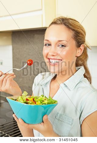 Happy Young Woman With Salad