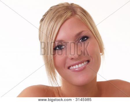 Young Blond Woman With Half Smile Portrait