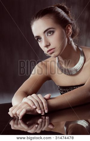 brunette woman with silver jewellery