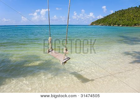 Tropical Beach With Coconut Palm Trees  And Old  Swing Tied To   Tree