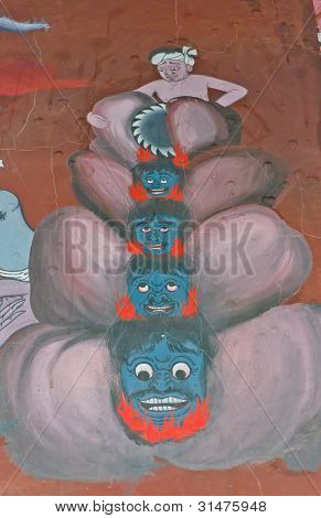 A pintura Mural de uma Excucetioner cortar cabeças de pessoas pecadoras no inferno