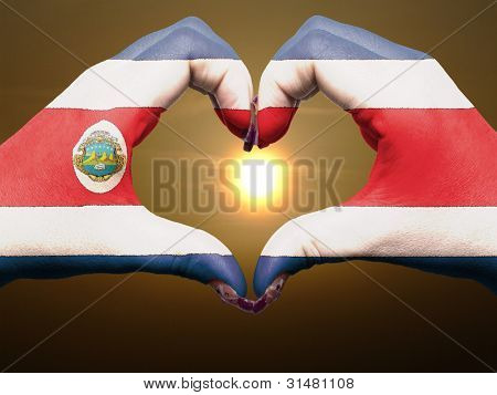 Heart And Love Gesture By Hands Colored In Costa Rica Flag During Beautiful Sunrise