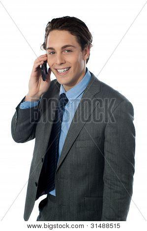 Portrait Of A Smiling Businessman Using A Cellphone