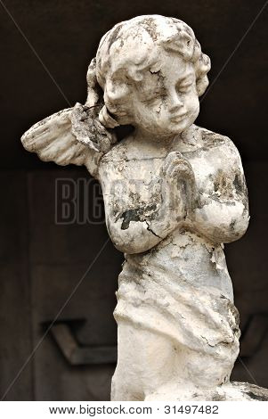 Old Crumbling Cherub Angel Statue