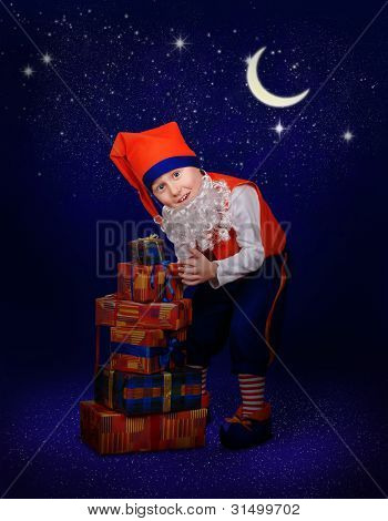 Funny Little Gnome With Christmas Gift At The Night