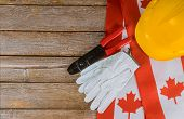 Canadian Flag Happy Labor Day Canada Two Protective Hardhats Top View Concept Of Labor And Employmen poster