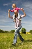 stock photo of father daughter  - Young father with his daughter running fast - JPG