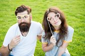 Stay Focused With Best Goggles. Couple In Love Looking Through Prop Goggles On Green Grass. Sensual  poster